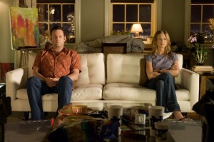 An Image of Jennifer Anniston and Vince Vaughn sitting on a white couch far apart from each other