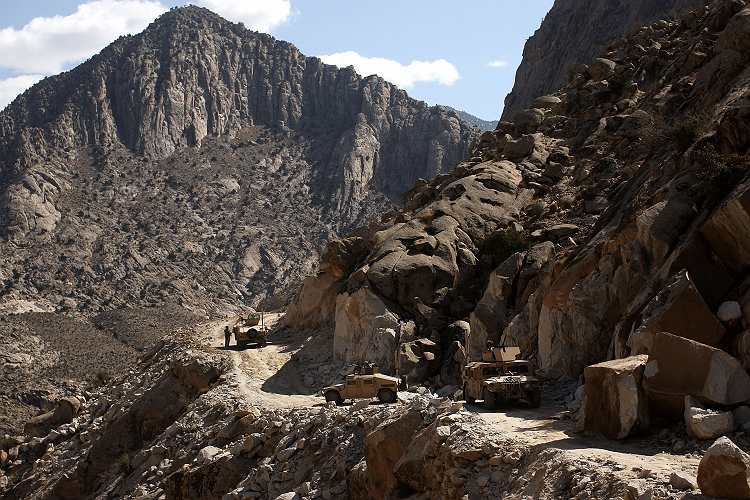 An image of a US army patrol in the mountains of Afghanistan