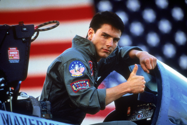 Image of Tom Cruise with his thumbs up in a cockpit from movie Top Gun