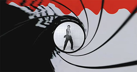 An image of the starting of James Bond with Bond at the end of the gun barrel shooting back towards the audience