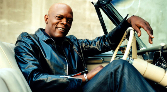 An image of Samuel L Jackson sitting in a car looking bad ass