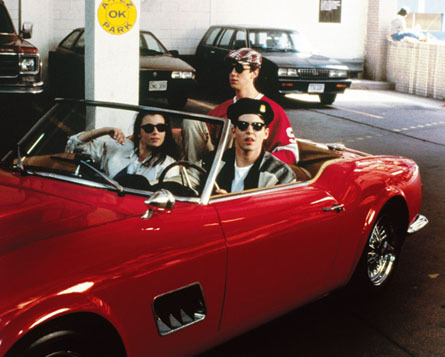 An image of Ferris Bueller and two friends in a red classic ferrari