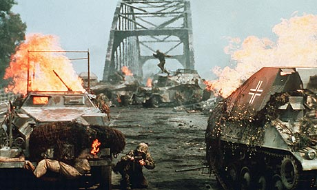 An Image from the Movie A Bridge To Far with tanks on fire laden across the bridge