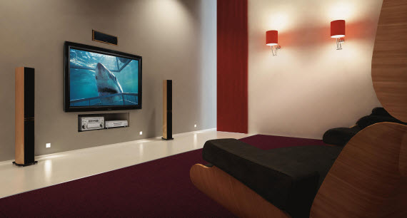 An image of a modern lounge with a high tech Home Theater system in it with Jaws playing