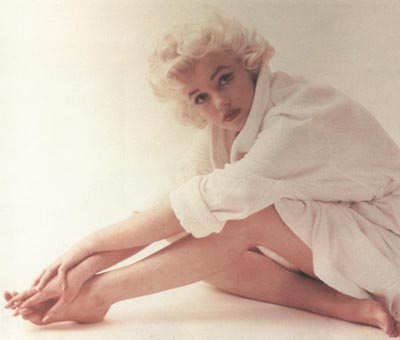 An Image of Marilyn Monroe posing in a white shirt