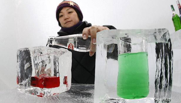 An image of a waitress making a cocktail in an ice bar.