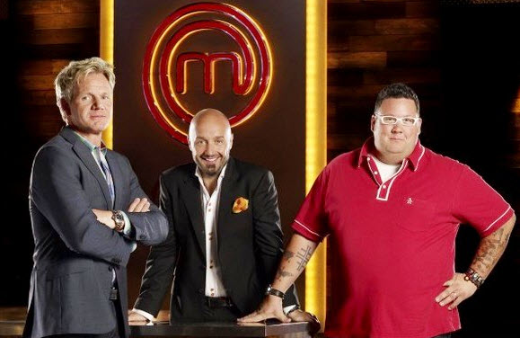 An image of Gordon Ramsay, Graham Elliot and Joe Bastianich standing over a table on the new US version of Masterchef
