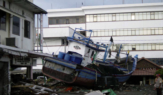 An image of a boat that has been moved into the city during the Indian Ocean Tsunami
