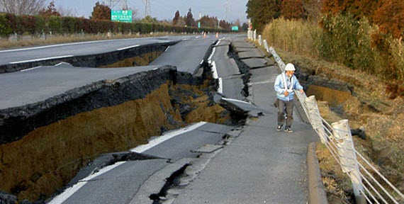 An image of a road that has collapse and subsided due to an earthquake fissure
