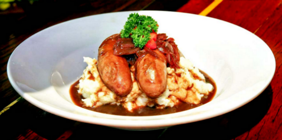 An image of Bangers and Mash or commonly known as sausages and mash potatoes