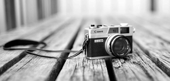 An image of a retro camera sitting a deck