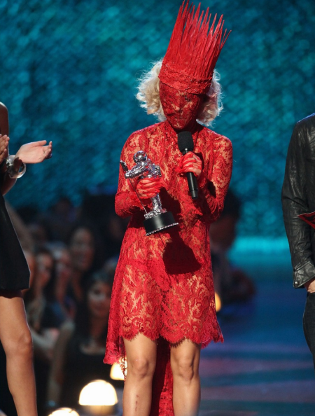 An image of Lady Gaga at the VMAs dressed completely in red lace