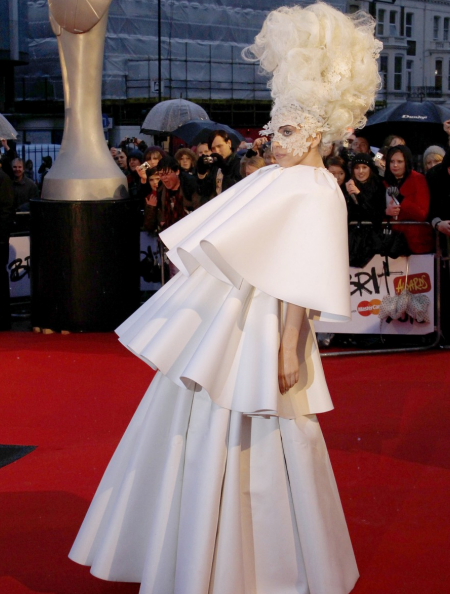An image of Lady Gaga in a tiered white dress at the Brit Awards