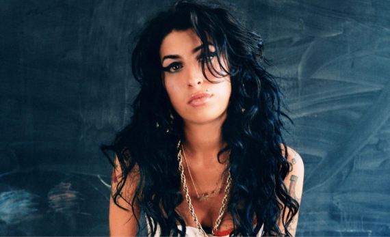 An image of Amy Winehouse before the drugs took hold and killed her at 27.