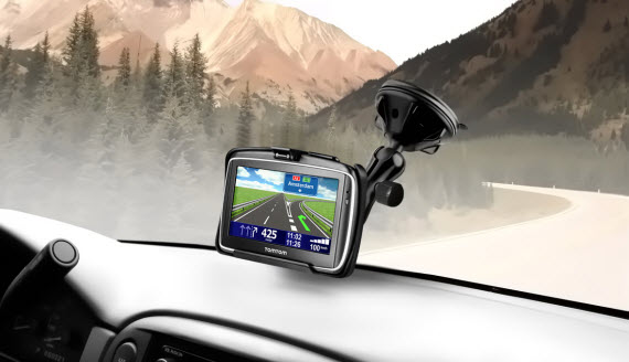 An image of the TomTom GPS Navigator on the dashboard of a car