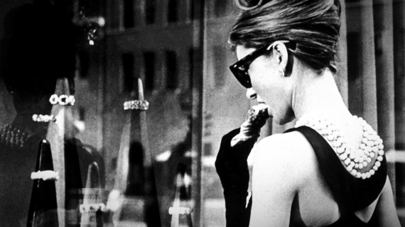 An image of Audrey Hepburn looking at the gift of diamonds in Breakfast at Tiffany's