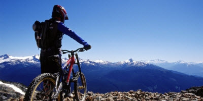 An image of a mountain biker in Whistler during the summer.