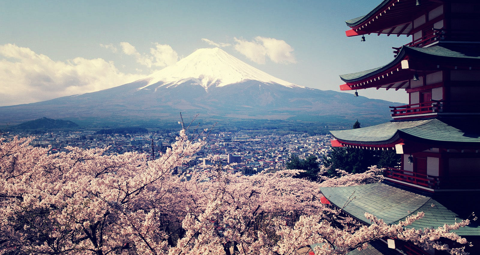 An image of Mt Fuji and ancient Japanese Home